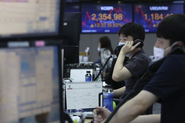 Asian markets slide as China-U.S. exchange pressures rise