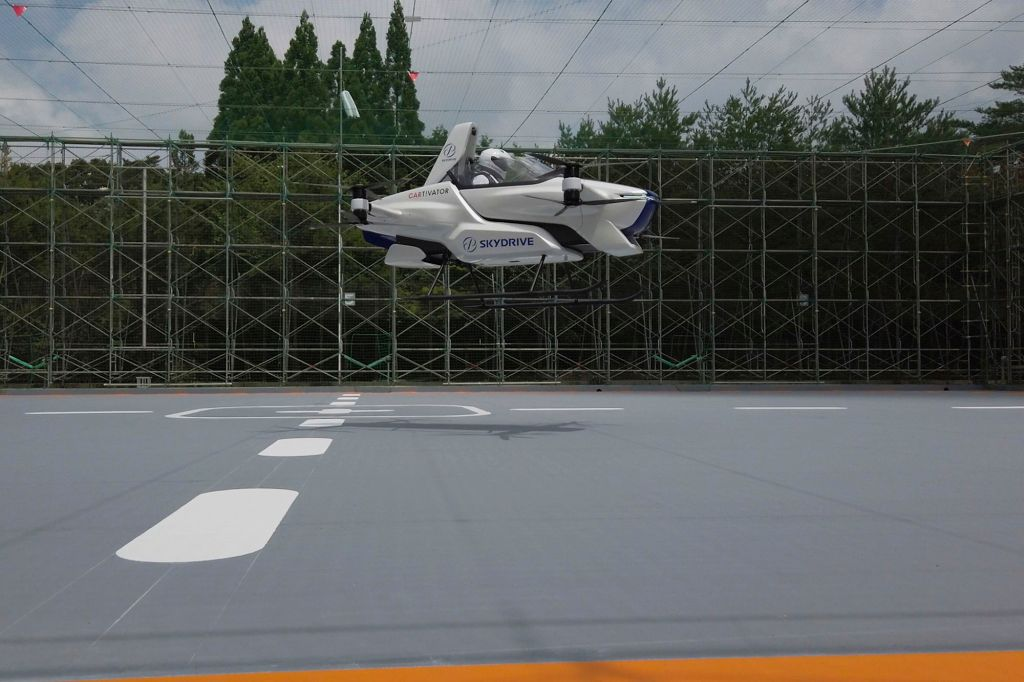 Japan's flying vehicle takes off in practice run with traveler on board